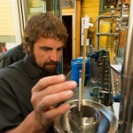 Eric Robinson, Assistant Distiller, checking proof of the whiskey